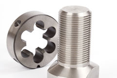 Cylindrical workpiece and button die Stock Images