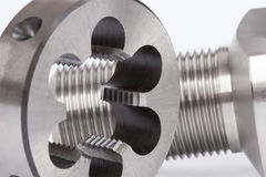 Cylindrical workpiece and button die Stock Photo
