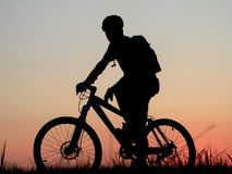 Cyling. Mountain biker silhouette Royalty Free Stock Photography
