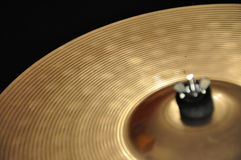 Cymbal. Parts of a cymbal at black background Royalty Free Stock Photo