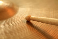 Cymbal and drumstick. Photo of a drumstick playing on a hi-hat or ride cymbal.  Focus on tip of stick Royalty Free Stock Photography