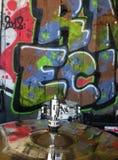 Cymbal with graffiti reflection. Graffiti wall behind cymbal that reflects graffiti lettering royalty free stock photo
