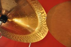 Cymbals. Parts of two cymblas at red background Royalty Free Stock Images