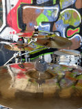 Cymbals on a drumkit with graffiti. Graffiti wall behind drum-set with cymbals that reflect graffiti Royalty Free Stock Photos