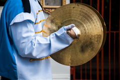 Cymbals in hand Royalty Free Stock Photography