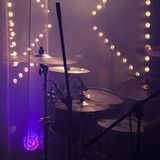 Cymbals in stage lights. Close-up square photo. Live rock music photo background, rock drum set with cymbals in stage lights. Close-up square photo, soft stock images