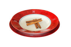 Cynamon on red plate Royalty Free Stock Photography