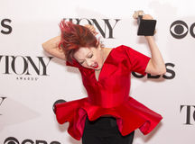 Cyndi Lauper. Singer/songwriter, pop diva and icon Cyndi Lauper jumps for joy in the Press Room at 3 West 51st Street in New York City.  This was 2 blocks and 2 Royalty Free Stock Photo