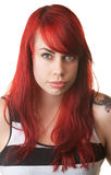 Cynical Lady in Striped Shirt and Red Hair Royalty Free Stock Photography