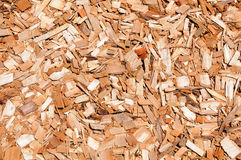 Cypress Mulch background. Chips of orange cypress mulch for background use royalty free stock images
