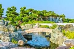 Cypresses emerge to the stone bridge Royalty Free Stock Photos