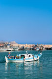 Cypriot fisherman in motor dory in Cyprus Stock Photo