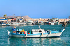 Cypriot fisherman in motor dory in Cyprus Stock Image