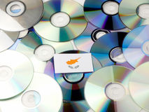 Cypriot flag on top of CD and DVD pile isolated on white Royalty Free Stock Photos