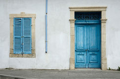 Cypriot old house with blue door and window Stock Images