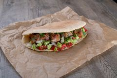 Cypriot Souvlaki in Pitta Bread. A traditional dish from cyprus. Pork kebab is grilled on charcoals and then served in Pitta bread with salad royalty free stock image