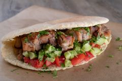 Cypriot Souvlaki in Pitta Bread. A traditional dish from cyprus. Pork kebab is grilled on charcoals and then served in Pitta bread with salad royalty free stock images