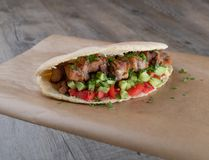Cypriot Souvlaki in Pitta Bread. A traditional dish from cyprus. Pork kebab is grilled on charcoals and then served in Pitta bread with salad royalty free stock photo