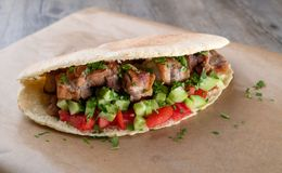 Cypriot Souvlaki in Pitta Bread. A traditional dish from cyprus. Pork kebab is grilled on charcoals and then served in Pitta bread with salad stock photos