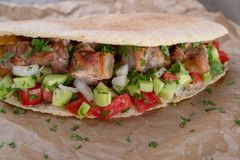 Cypriot Souvlaki in Pitta Bread. A traditional dish from cyprus. Pork kebab is grilled on charcoals and then served in Pitta bread with salad stock photography
