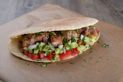 Cypriot Souvlaki in Pitta Bread. A traditional dish from cyprus. Pork kebab is grilled on charcoals and then served in Pitta bread with salad stock photo