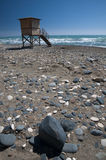 Cyprus Beach and lifeguard tower. With rocks and sea Royalty Free Stock Images