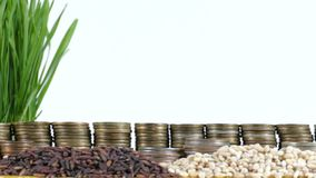 Cyprus flag waving with stack of money coins and piles of wheat. And rice seeds stock video