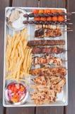 Cyprus food. Local traditional Cyprus food , halloumi cheese , chicken souvlakia , potato , pittas , pork, olive , salad and sauce stock images