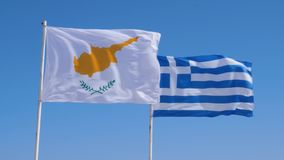 Cyprus and greek flags flapping in wind on a pole. Blue sky, greek and cyprus flag.  stock footage