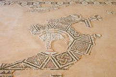 Cyprus, Kourion, Roman amphitheater. Archaeological site and the beach. Kourion, Fragmentary welcoming mosaic inscription Royalty Free Stock Photo