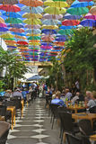 Cyprus, Kyrenia. Nicosia, Cyprus - October 20th 2015: Unidentified people in restaurant with colorful umbrellas for sun protection Royalty Free Stock Photo
