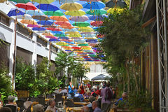 Cyprus, Kyrenia. Nicosia, Cyprus - October 20th 2015: Unidentified people in restaurant with colorful umbrellas for sun protection Royalty Free Stock Image
