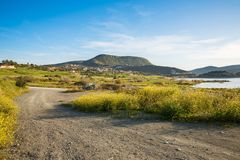 Cyprus landscape. With mountains, lake and village Stock Images