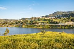 Cyprus landscape. With mountains, lake and village Stock Photos
