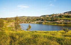 Cyprus landscape. With mountains, lake and village Stock Photography