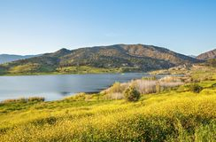 Cyprus landscape. With mountains, lake and village Stock Photo