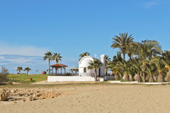 Cyprus. Landscape view at small white chapel church at the beach with palms, taken in Ayia Napa, Cyprus Stock Photo