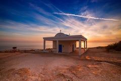 Agioi Anargyroi church. Cyprus, Mediterranean Sea coast. Agioi Anargyroi church at Cape Greco at sunrise Royalty Free Stock Images