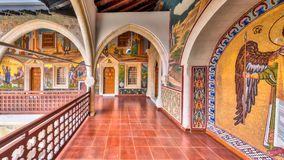 Arcade in monastery with mosaics inlaid with gold. CYPRUS, PAPHOS- MAY 2 2016: Arcade in Kykkos monastery with famous mosaics inlaid with gold Royalty Free Stock Photo
