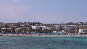 Cyprus, Ayia Napa, Sea Resort, rest on the sea beach, people bathe and sunbathe on the sea beach. Cyprus, people bathe and sunbathe on the sea beach, sun stock footage