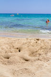 Cyprus. Protaras. Beach sculpture in the form of sunbathing man made of sand on the beach children. Royalty Free Stock Photo