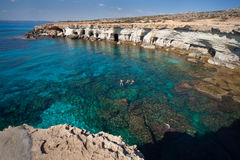 Cyprus sea caves. Father with two sons swim. Stock Photography