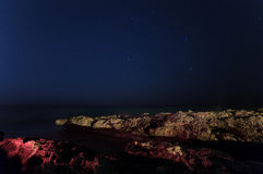 Cyprus. The starry sky and the sea. Horizon. Volcanic bay. promontory stretching into the sea. Stock Photography