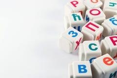 Cyrillicbokstäver på kuber Arkivfoto