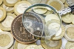Cyripto money mining. close up physical bitcoin coin. With turkish metal coins royalty free stock photos