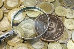 Cyripto money mining. close up physical bitcoin coin. With turkish metal coins royalty free stock image