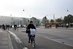 Cyslists on a street in Copenhagen, Denmark Stock Photos