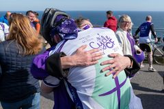 Cystic Fibrosis Fund Raising Cycle Race, May, 12, 2019: Spectator hugs a rider at the finish of the Cycle 4 CF fund stock image
