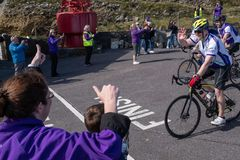 Cystic Fibrosis Fund Raising Cycle Race, May, 12, 2019: Spectators cheer the riders at the finish of the Cycle 4 CF fund stock photography