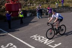 Cystic Fibrosis Fund Raising Cycle Race, May, 12, 2019: Spectators cheer the riders at the finish of the Cycle 4 CF fund royalty free stock images